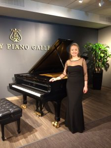 Elena Goptseva by the piano at Syeinway Piano Gallery.
